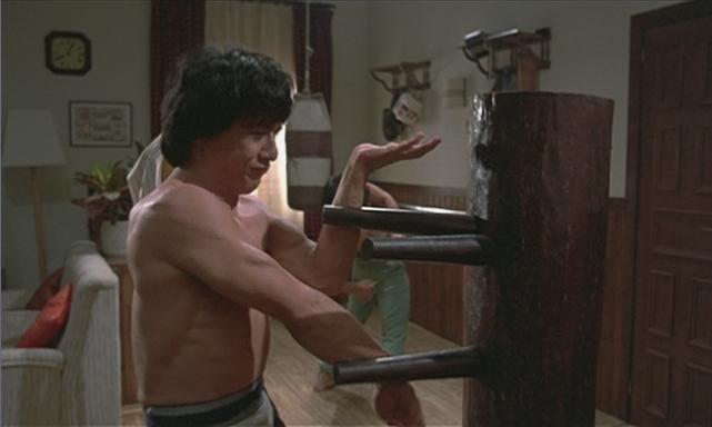 Jackie Chan practicing a block on the Wing Chun Dummy